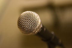 Shure SM-58 microphone. On a stand Royalty Free Stock Images
