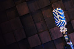 SHURE Super 55 Deluxe. MINSK, BELARUS - SEPTEMBER 29, 2015: Silver old fashioned stage microphone- SHURE Super 55 Deluxe against wood background. Karaoke, vocal Royalty Free Stock Images