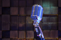 SHURE Super 55 Deluxe. MINSK, BELARUS - SEPTEMBER 29, 2015: Silver old fashioned stage microphone- SHURE Super 55 Deluxe against wood background. Voice recording Royalty Free Stock Photography