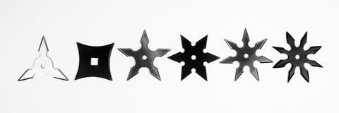 Shurikens на белой предпосылке Стоковые Фото