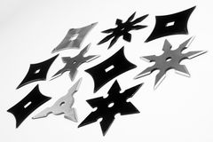 Shurikens on white background Royalty Free Stock Images