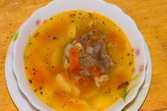 Shurpa - mutton soup. Shurpa - traditional mutton soup in Central Asia on a wooden background stock images
