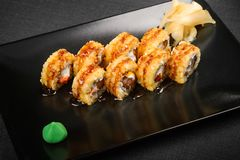 Shushi on a black plate royalty free stock photography