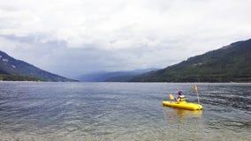 Shuswap kayaking. Picture of a young boy kayaking on Shuswap Lake,British Columbia,Canada stock photo