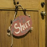 Shut. Sign notifies everyone to keep the door shut - which it is Royalty Free Stock Photo