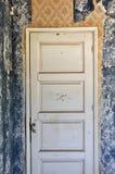 Shut door in abandoned house Royalty Free Stock Photo