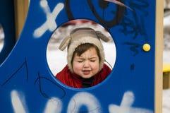 Shut eyes tight. Boy shutting eyes tight at winter day Stock Image