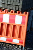 Shut off. Barrier with safety fence on building site Royalty Free Stock Photo