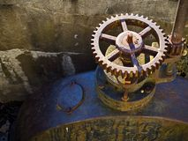 Shut-Off Sprocket Valve. A industrial shut-off sprocket valve and tank from a small dam royalty free stock photo