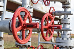 Shut-off valve valve with manual drive. Red steering wheel lock gate valve. oil well equipment Stock Images