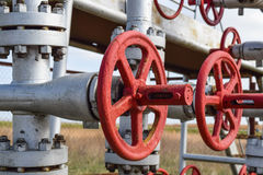 Shut-off valve valve with manual drive. Red steering wheel lock gate valve. oil well equipment Royalty Free Stock Photo