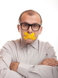 Shut up. Adult businessman with taped mouth  on white background Stock Photography