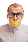 Shut up. Adult businessman with taped mouth  on white background Royalty Free Stock Image
