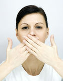 Shut up!. A young woman with her mouth shut Stock Photos