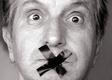 Shut Up !. Censure!stop talking! man with adhesive tape over his mouth. sepia tone stock images