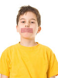 Shut up, boy!. Boy with adhesive tape on mouth royalty free stock photos