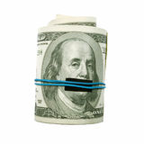 Shut Up! One hundred bill mouth covered. This photograph represent a roll of hundred dollar bills with Benjamin Franklin mouth taped shut Stock Photo