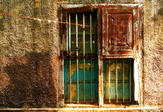 Shut from the world. The half opened window with dark grungy on an abadoned desolated house on a street side of Jew Street,Kochi,Kerala Stock Photo