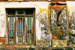 Shut from the world. The half opened window with dark grungy on an abadoned desolated house on a street side of Jew Street,Kochi,Kerala Stock Images