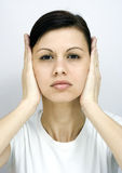 Shut your ears!. The young woman shut her ears Stock Photo
