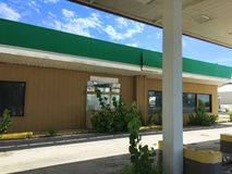 Closed green white and tan gas station 04 Royalty Free Stock Images