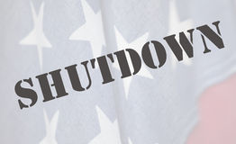 Shutdown word on American flag Stock Photos