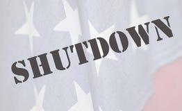 Shutdown word on American flag stock photos