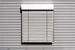 Shutter. A grey window shutter in sunlight royalty free stock photo