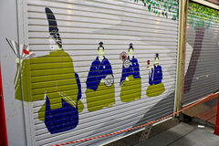 Shutter Art in Tokyo. In Japan, closed shutters of establishments and residences often reveal lovely murals. They depict all sorts of things from traditional Stock Photo