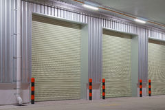 Shutter door. Exterior of factory with shutter door, night time Stock Photo