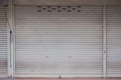 Shutter door old white iron close in market stock images