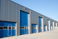 Shutter doors. Industrial Unit with roller shutter doors Royalty Free Stock Photo