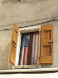 Shutter flag. Shutters on building showing USA flag Royalty Free Stock Image