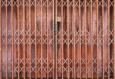 Shutter metal door old and rusty. Doors open shop buildings in the past that can be open or closed for security.  royalty free stock photos
