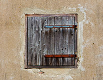 Shutter in old concrete wall of  house Royalty Free Stock Photography