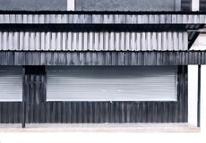 Shutter roller door aluminium and sheet metal zinc texture corr. Ugated gray and black with copy space for text. Design for a restaurant stock photos