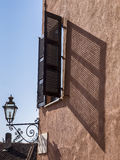 Shutter in Saluzzo. Old wooden window shutters in Saluzzo Stock Photography