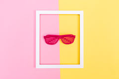 Shutter shades sunglasses on a vibrant background Stock Photography