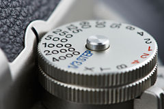 Shutter speed dial on SLR camera. Closeup Stock Image