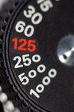 Shutter speed knob. A shutter speed knob of an old film camera stock photos