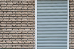 Shuttered door in wall Royalty Free Stock Image