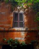 Shuttered window Stock Photo