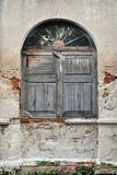 Shuttered Window. Of a Derelict Building Royalty Free Stock Photos