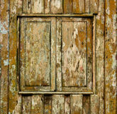 Shuttered window of old wooden house Royalty Free Stock Photo