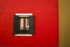 Window on a red wall, Burano, Italy Royalty Free Stock Photo