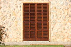Shuttered window in a stone building Royalty Free Stock Photos