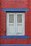 Shuttered Window. View of Shuttered Window of an Old Red Brick House with Plenty of Copy Space Stock Photography