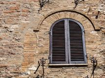 The Enchanting Streets of Asssi. Shuttered windows along the enchanting streets of Assisi, Italy stock photos