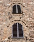 The Enchanting Streets of Asssi. Shuttered windows along the enchanting streets of Assisi, Italy royalty free stock photography
