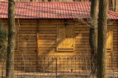 Shuttered windows in a wooden house stock images